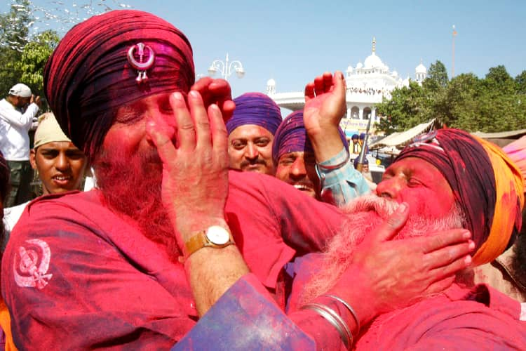 On the day of Holi, people in Anandpur Sahib are enjoying each other's colors